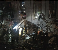 Firefighters rush to save quake victims