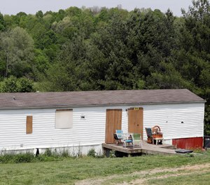 The home where six people were found killed Saturday, April 27, has its doors and windows covered Tuesday, April 30, 2019, in Westmoreland, Tenn.  (AP Photo/Mark Humphrey)