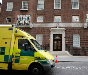 An ambulance passes the entrance to the Lindo Wing at St Mary's Hospital in London, Tuesday, July 2, 2013. (AP Photo/Frank Augstein)