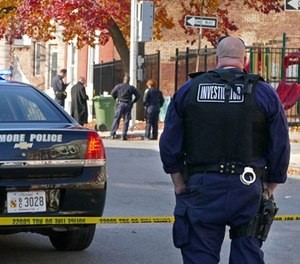 Baltimore police investigate a shooting on Nov. 30, 2017. (Lloyd Fox/Baltimore Sun/TNS)