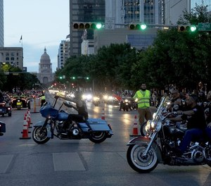 Bikers parade down Congress Avenue on Friday night to kick off the 2019 Republic of Texas Biker Rally.(Photo/ Tribune News Service)