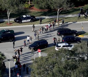 Sub.  Students are evacuated by police out of Stoneman Douglas High School in Parkland, Fla., after a shooting on February 14, 2018. (Mike Stocker/Sun Sentinel/TNS)