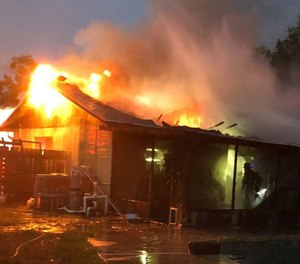 Firefighters rescued a woman who became overcome with smoke after re-entering a burning home near Valrico to retrieve her medication on May 27, 2019. (Photo/Hillsborough County Fire Rescue)