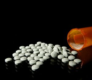 OxyContin 80 mg pills in an August 2013 file image. A federal appeals court has upheld the conviction of a former Hazard doctor and his wife accused of improperly prescribing pain pills. (Liz O. Baylen/Los Angeles Times/TNS)