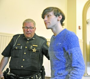 Travis Cottrell returned to jail after a court appearance. (Photo/Mike Schenk/Record-Courier)