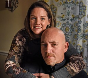 Dan Gosnell with his wife, Noelle, at home. Gosnell, 40, a former Aberdeen police lieutenant, became addicted to opioids after neck surgery, and lost his career after he resorted to stealing drugs from the evidence vault at the police station. Gosnell now counsels addicts as a clinical aide at Harbor Grace Recovery Center, an in-patient addict treatment center. He is sharing his story as a cautionary tale for other cops. (Amy Davis/Baltimore Sun/TNS)