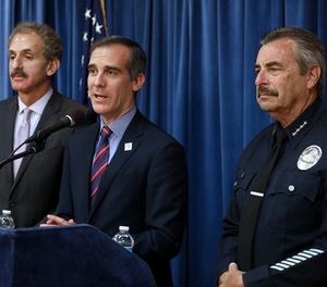 Los Angeles Mayor Eric Garcetti, center, flanked by Los Angeles City Attorney Mike Feuer, left, and LAPD Chief Charlie Beck, during a press conference detailing a court ruling against the Trump administration regarding its efforts to withhold federal grants from jurisdictions over their immigration enforcement policies on Thursday, April 12, 2018 at City Hall in Los Angeles, Calif. (Gary Coronado/Los Angeles Times/TNS)