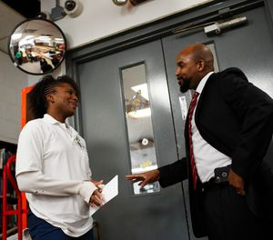 "Strawberry Hampton talks with Warden Glen Austin at Logan Correctional Center on Jan. 17, 2019, in Lincoln, Ill. Austin says he sees Hampton no differently from anyone else at the prison. ""People are who they are,"" he says. (Armando L. Sanchez/Chicago Tribune/TNS)"