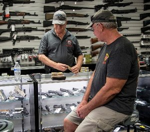 Mike Fiorille, business partner at Get Loaded, serves a customer at the gun store on June 30, 2016, in Grand Terrace, Calif. (Gina Ferazzi/Los Angeles Times/TNS)
