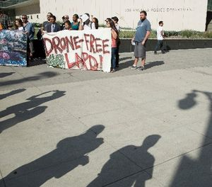 Protestors show their opposition to the LAPD getting drones on Aug. 8, 2017 in Los Angeles. (Myung J. Chun/Los Angeles Times/TNS)