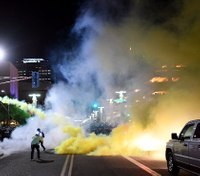Videos: Protesters throw objects at police during Phoenix Trump rally