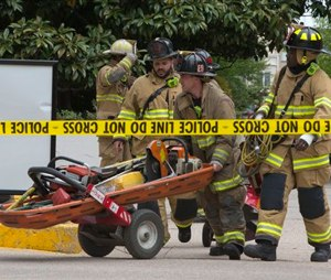 DC Fire Department move equipment into the garage at the Watergate complex after a structural collapse incident.(AP Photo/Jacquelyn Martin)