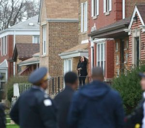 Authorities gather outside a home on the South Side of Chicago, Monday morning, April 10, 2017, after Cook County Circuit Court Judge Raymond Myles was shot to death outside his home. (Zbigniew Bzdak/Chicago Tribune via AP)