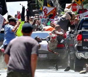 In this Aug. 12, 2017 file photo, people fly into the air as a vehicle is driven into a group of protesters demonstrating against a white nationalist rally in Charlottesville, Va. (Ryan M. Kelly/The Daily Progress via AP, File)