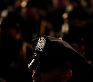 New graduates of the Police Academy participate in a graduation ceremony in New York, Wednesday, Dec. 28, 2016. (AP Photo/Seth Wenig)