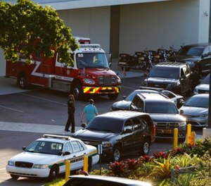 Police and rescue vehicles are shown outside Broward Health North hospital, Wednesday, Feb. 14, 2018, in Deerfield Beach, Fla. (AP Photo/Joe Skipper)