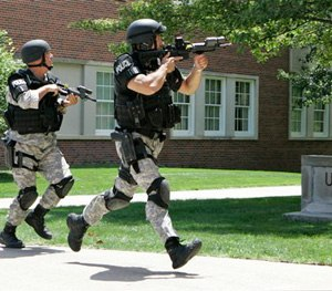 "Police officers from the Omaha Emergency Response Unit conduct ""Active Shooter"" training on the campus of the University of Nebraska at Omaha. (AP Photo)"