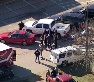 This photo from video by KDFW Fox4 shows law enforcement personnel gathered outside a high school in Italy, Texas, following an active shooter incident at the school Monday morning, Jan. 22, 2018. (Photo/KDFW Fox4 via AP)