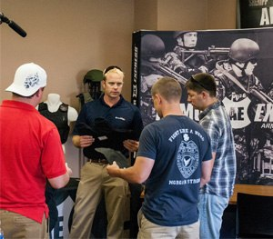 Armor Express CEO Matt Davis takes officers through the process of what goes into making ballistic armor as part of the Saves Retreat. (Photo courtesy Armor Express)