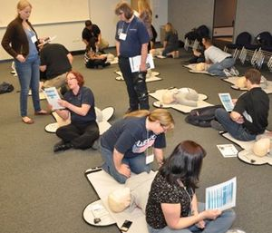 Dispatchers role-play in exercises designed to increase recognition of cardiac arrest and provision of CPR instructions over the phone. (Photo/Chris Minnick)