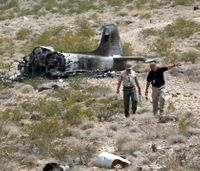 Pilot survives vintage military jet fire near Nev. airport