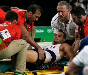 France's Samir Ait Said is assisted after injuring his leg in the vault, Saturday, Aug. 6, 2016. (AP Photo/Rebecca Blackwell)