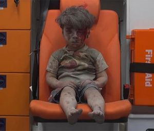 A child sits in an ambulance after being pulled out or a building hit by an airstirke, in Aleppo, Syria, Wednesday, Aug. 17, 2016. (Photo/Aleppo Media Center via AP)
