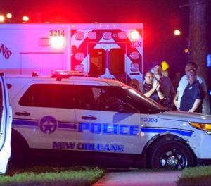 A suspect in the shooting of a New Orleans Police officer leaves in an ambulance near the Cypress Parc Apartments in New Orleans, La., early Friday, Oct. 13, 2017. (Matthew Hinton/The Advocate via AP)