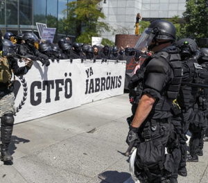 Portland police keep Patriot Prayer affiliates separate from antifa protesters during a rally in Portland, Ore., Saturday, Aug. 4, 2018. (AP Photo/John Rudoff)