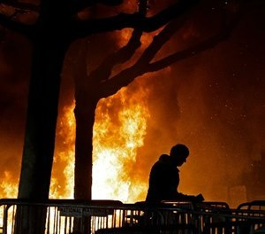 A fire set by demonstrators protesting a scheduled speaking appearance by Milo Yiannopoulos, Feb. 1, 2017, in Berkeley, Calif. (AP Photo/Ben Margot)