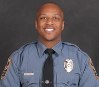 Ga. officer fatally shot while investigating suspicious vehicle