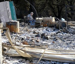The causes of the October conflagrations areunder investigation. (Photo/AP)