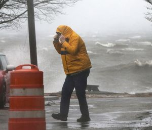 An 11-year-old boy in New York state is the fifth person reported killed by downed trees in a fierce winter storm bringing high winds and heavy rain to the East Coast. (Photo/AP)