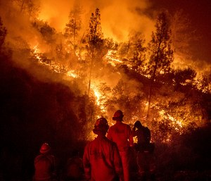 Around 98 firefighters are being deployed from 29 different Texas fire departments to California in an activation of the Texas Intrastate Fire Mutual Aid System. (Photo/AP)