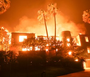 Six days after the Woolseyfirebroke out, killing two people and burning more than 98,000 acres and growing, five engines from Washington State made their way to California to help fight the blaze. (Photo/AP)