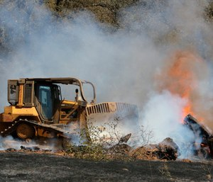 Agriculture Secretary Sonny Perdue said the Forest Service and other agencies will step up efforts to cut down small trees and underbrush and set controlled fires. (Photo/AP)