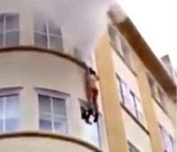 Video: Woman jumps from burning apartment, survives