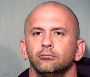 Ryan Donahue is accused of entering fire stations and stealing from fellow firefighters, sometimes after setting trash fires to keep fire crews away. (Photo/Maricopa County Sheriff's Office)