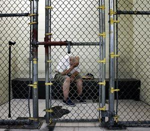 In this June 26, 2014 photo, a U.S. veteran with post-traumatic stress sits in a segregated holding pen at the Cook County Jail after he was arrested on a narcotics charge in Chicago. (AP Image)