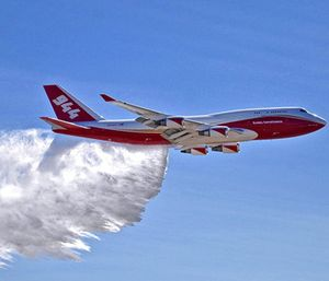 a Boeing 747 making a demonstration water drop at Colorado Springs Airport in Colorado Springs, Colo. (Hiroshi Ando/Global Super Tanker Services LLC via AP)