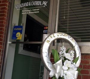 A memorial sits outside the office of defense attorney Mark Stanziano Friday morning, June 27, 2014, in Somerset, Ky. Somerset police say the 57-year-old Stanziano was shot and killed Friday morning outside his office. (AP Image)