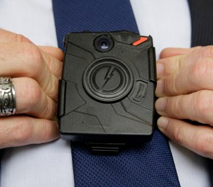 In this Feb. 19, 2015 file photo, Steve Tuttle, vice president of communications for Taser International, demonstrates one of the company's body cameras during a company-sponsored conference at the California Highway Patrol Headquarters in Sacramento, Calif. (AP Photo/Rich Pedroncelli,File)