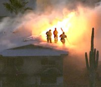 Ariz. firefighters dodge bullets during house fire