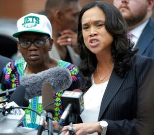In a Wednesday, July 27, 2016 file photo, Baltimore State's Attorney Marilyn Mosby, right, holds a news conference near the site where Freddie Gray was arrested after her office dropped the remaining charges against three Baltimore police officers awaiting trial in Gray's death, in Baltimore. (AP Photo/Steve Ruark, File)