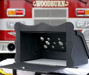 A prototype of a baby box, where parents could surrender their newborns anonymously, is shown outside the fire station in Woodburn, Ind. (AP Photo/Michael Conroy)