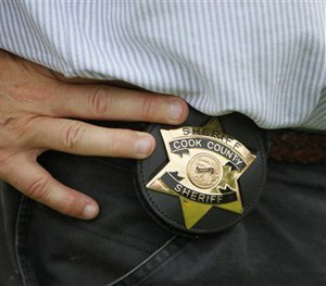 Becoming a cop is perhaps one of the most rigorous and trying experiences a person can have. (AP Image)