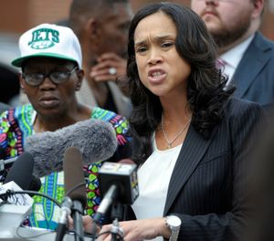 Baltimore State's Attorney Marilyn Mosby, right, holds a news conference near the site where Freddie Gray was arrested after her office dropped the remaining charges against three Baltimore police officers awaiting trial in Gray's death, in Baltimore. Mosby will no longer prosecute any marijuana possession cases, regardless of the quantity of the drug or an individual's prior criminal record, authorities announced Tuesday, Jan. 29, 2019. (AP Photo/Steve Ruark)