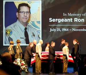 The flag draped casket of Ventura County Sheriff Sgt. Ron Helus arrives on stage for a memorial service for Sgt. Helus at Calvary Community Church in Westlake Village, Calif., Thursday, Nov. 15, 2018. (Al Seib /Los Angeles Times via AP, Pool)