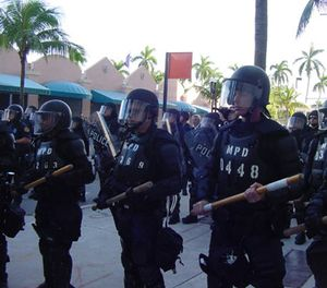 Riot police with batons at protests against the Free Trade Area of the Americas in Miami. (File Photo via Wikimedia Commons)