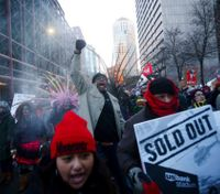 Police arrest 17 protesters who blocked trains near Super Bowl